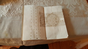Marie Yoho Dorsey Projects and Performances Notebook perforated with incense