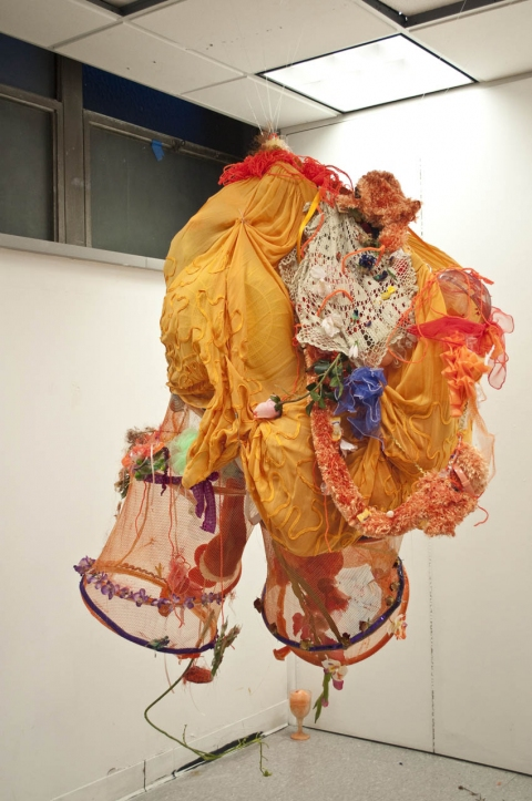 aimee hertog Installation and Sculpture Orange skirt, laundry baskets, lace, fake and real flowers, candy, loofah, plastic kitchen ware, yarn, pipe cleaners