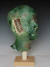 Busts High fire paper clay, glaze, aluminum wire
