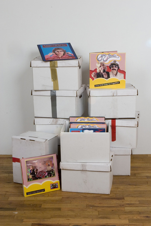 Captain & Tennille archival paper, found album covers, cardboard, and tape