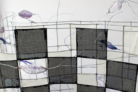 ANN STODDARD 2019 : On The Far Edge of The Visibility Field,  Fencing, Wire, digital print on organza, organza, screen mesh, found vinyl mesh, mylar, clay