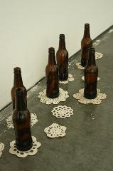 Ashley V. Blalock Archive beer bottles and doilies