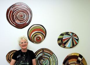 Barbara with Layered Discs wall