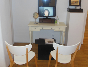 Barbara Lubliner No More Dy(e)ing   ....   video installation video, vanity table, chairs,  mirrors, book of names