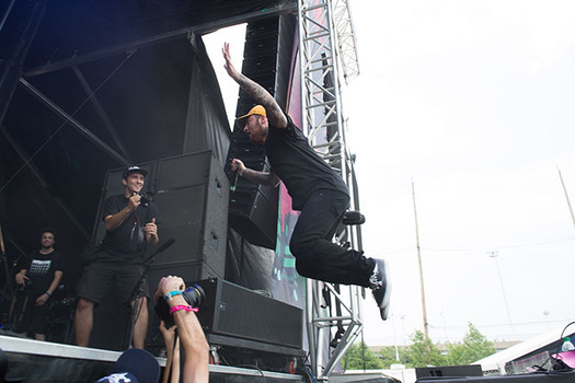 Mac Miller leaps to the stage at the Governors Ball Music Festival