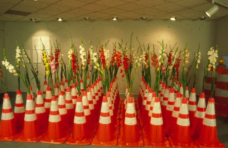 Cindy Tower Viewers as Creators Traffic cones lent by local highway department with gladiola flowers grown by the local  garden club.