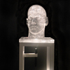 The Human Form Cast glass, steel sculpture stand, Mag-Lite