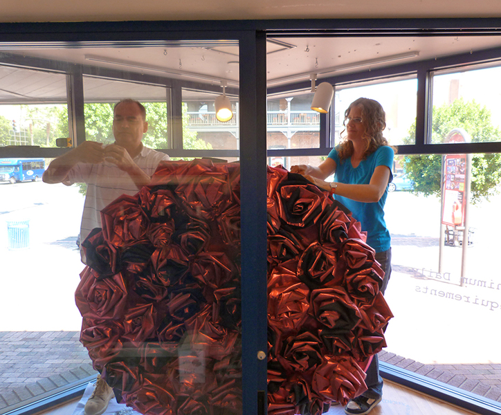 Push Down & Tango Installing the Rose Cluster inside the Post Office window