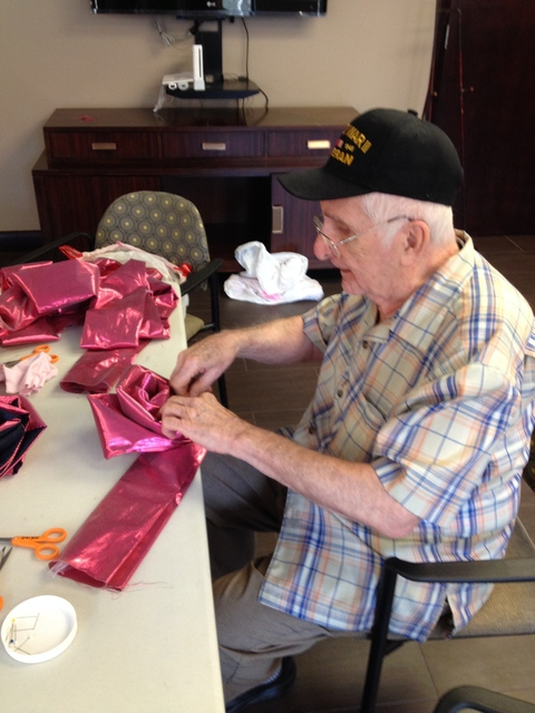Push Down & Tango Senior community member hand sews Resiliency Rose at Maker Party.