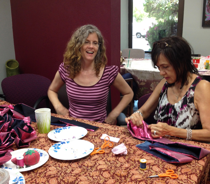 Push Down & Tango The artist coaches a Maker in sewing a Resiliency Rose at the first Maker Party.