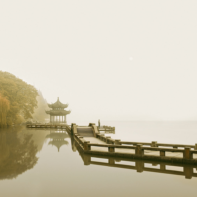 ASIA Man Watching Sunrise, West Lake, Hangzhou, China, 2011