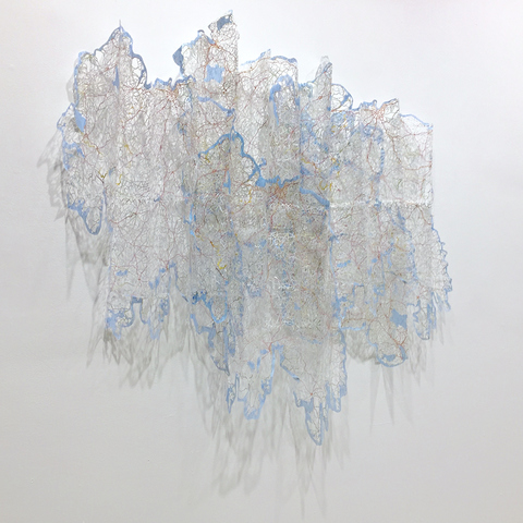 Elizabeth Duffy Map Projects hand cut maps, refolded, layered and mounted on the wall