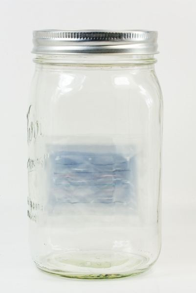 "Digital Files of Artists Yuko Parris,Moment Ago #5, 6.5""H x 3.5""W x 3.5""W, vinyl, threads, and glass bin, 2013"