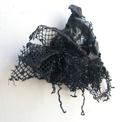 Gilda Pervin Wall Sculpture 1 Acrylic paint, netting, found objects, plastic shavings, burlap
