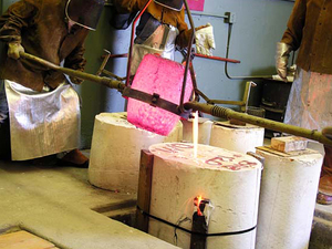 Harry Powers Cosmology Pouring molten bronze into a plaster mold