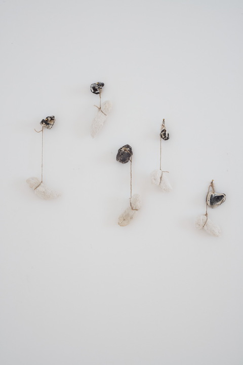 heather sheehan installation + object cloth objects, Baltic Sea stones, jute twine, body fluids