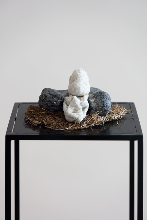 heather sheehan installation + object cloth object, Baltic Sea stone, straw bed