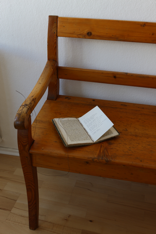 heather sheehan installed texts typewritten poem sewn into antique book tied to bench