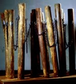 HJ BOTT  BEFORE DoV; earlier than March 7, 1972   Bonded & rusted resins on carpet tubes and rusted chain on a rolling plinth
