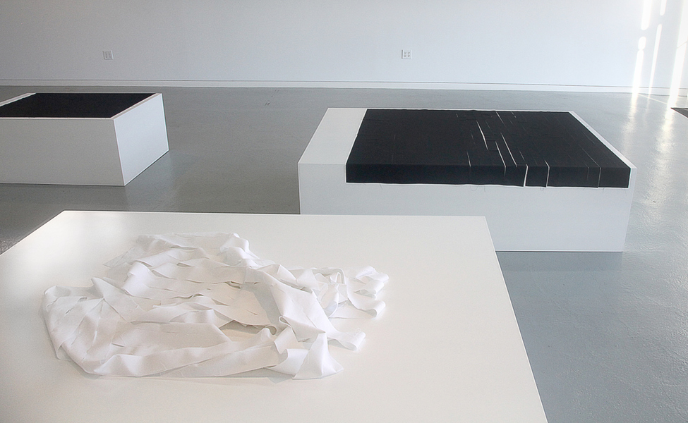 Slideshow Foreground: White Grass, cloth on white plinth, 20 x  72 x 48, cloth size variable. Background: Rain, 2017, cloth on white plinth 20 x 72 x 48 inches. ODETTA, Brooklyn, NY.