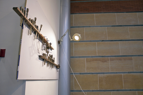 Installation Images Drywall, Cast Bronze (including 30 sharpened cast bronze chisels, and 2 cast scribbles), Wood, Brass, C Clamps, Shop Light