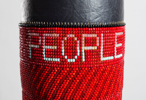 People Like Us Found canvas punching bag, repurposed wool army blanket, glass beads, tin jingles, nylon fringe, artificial sinew, acrylic paint