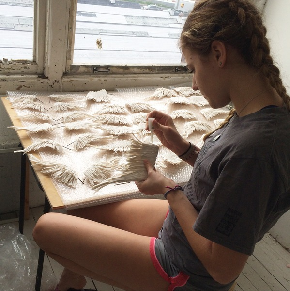 United  - Process  Josephine (intern), prepping wings to be hung