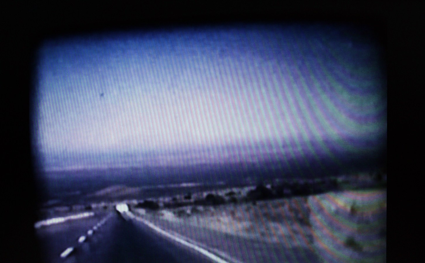 Narrative Project Still from Family Landscape (Video), Scene from I-10