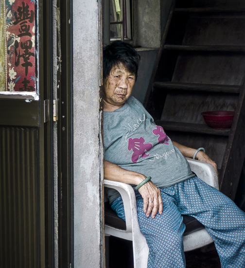 Finding Wuzhen J01-002 Woman Sitting at the Door