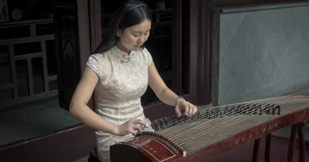 Finding Wuzhen J01-006 Woman Playing Guzheng