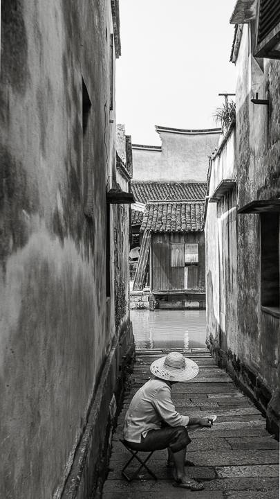 Finding Wuzhen J01-009 Woman Sitting in an Alley