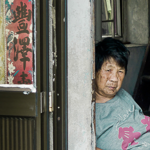 J01-002 Woman Sitting at the Door