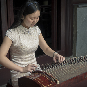J01-006 Woman Playing Guzheng