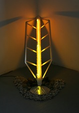 Lisa E. Nanni Installations  aluminum, art glass, colored glass tubing, argon gas, river rocks, transformer