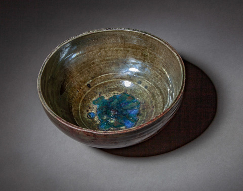 Raku, Pit Fire and Luster ware Copper luster bowl with glass inclusions