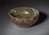 Copper luster bowl with glass inclusions