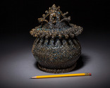 Frilly lidded jar, size detail