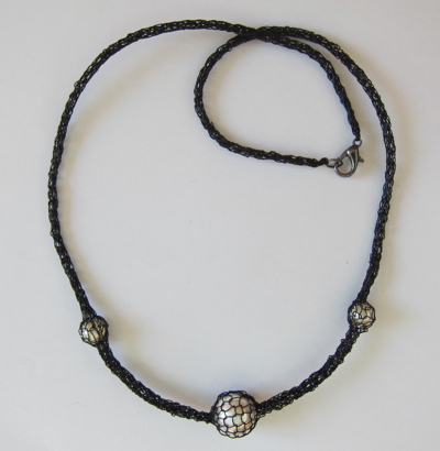 Necklaces Caged Pearl Necklace, black