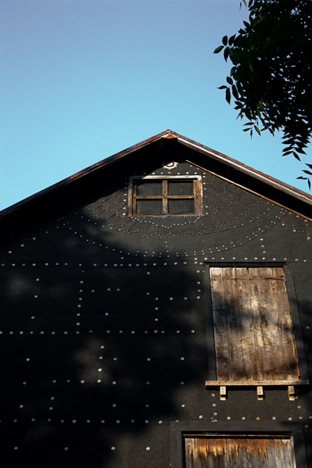Black Barn mineral surface rolled roofing, cap nails, wood, paint