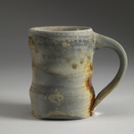Cups and Mugs porcelaineous stoneware, red shino liner, natural ash glaze