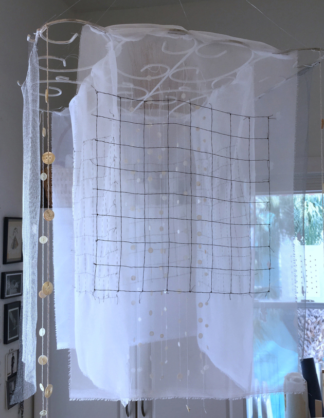 Meg Pierce Stitch + Layered Hangings 2018 hand-stitched organza, tulle, silk flowers, mother of pearl  buttons , yarn, salvaged wire structure