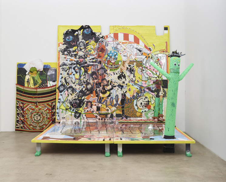 MIKE SHULTIS All American (2015-16) Oil, acrylic, latex, staples, vinyl, pillows, rug, cow hide,  wood, transparencies, sandals, string, mirror, paper,  plexiglass from Fancis Bacon triptych, LED lights,  inflatable AirDancer, and plastic cactus on panel