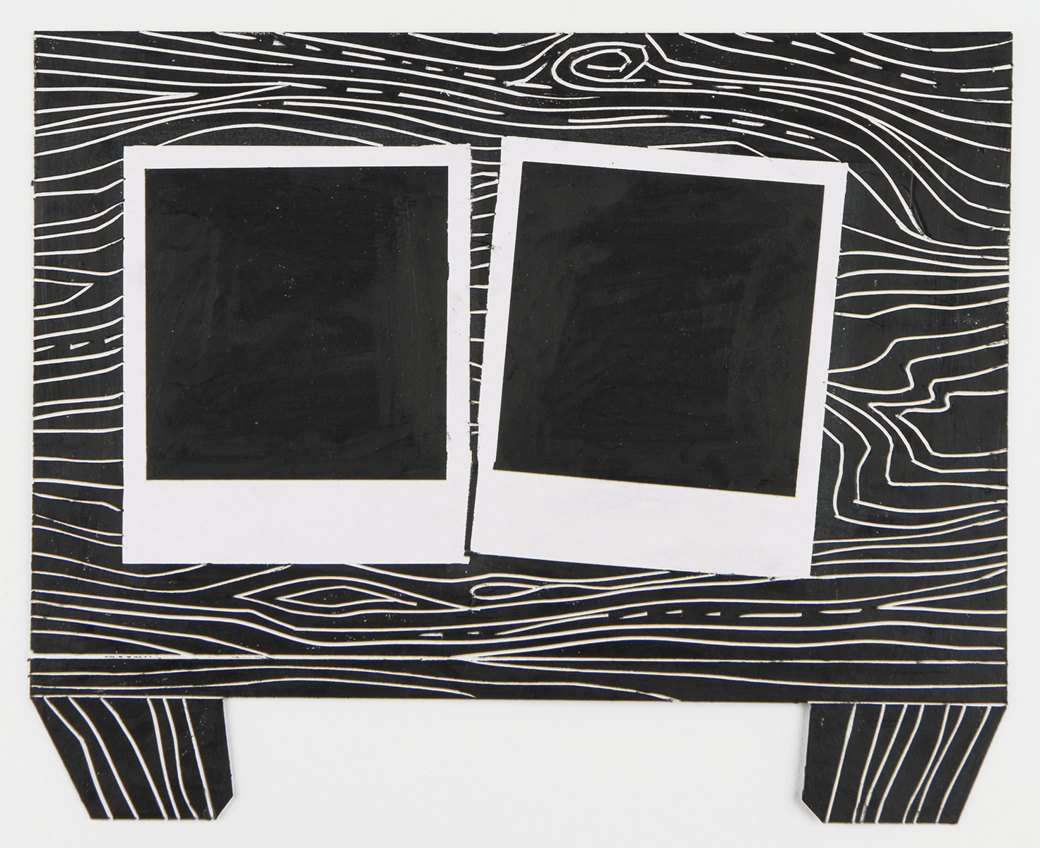 The Black Drawings Polaroids on Table