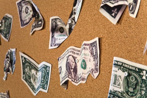 Money inkjet prints on paper, map pins, corkboard
