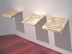 Pat Shannon Tabloids cut newspaper, acrylic gel, wood shelves