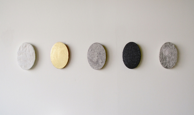 "Sarah McDougald Kohn 2010 L to R: ""Specimen: Plaster"" Plaster gauze & glue on wood; ""Specimen: Gold Leaf"" Gold leaf, acrylic, & varnish on wood; ""Specimen: Marble Dust"" Marble dust, glue, & burlap on wood; ""Specimen: Graphite"" Graphite, glue, & canvas on wood; ""Specimen: Paper"" Paper pulp, glue, & canvas on wood."