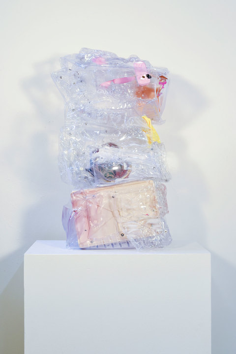 SARA HUBBS Unfurled plastic toy packages and containers, spray paint, fabric, glue, and rivets
