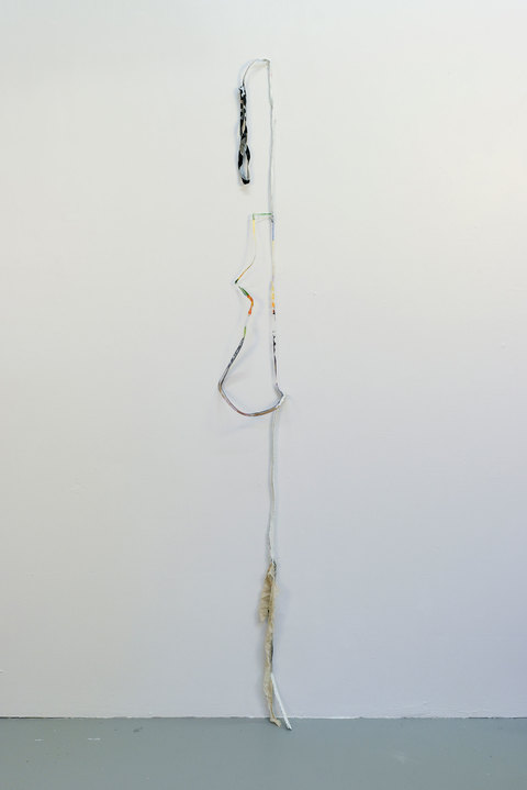 SARA HUBBS Unfurled plastic from toy packaging, clothing seams, gesso, thread, and pillowcase