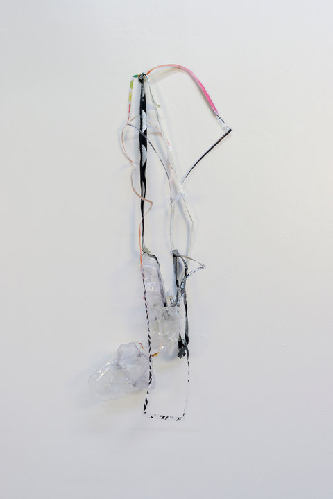 SARA HUBBS Unfurled plastic from toy packaging, clothing seams, gesso, thread, and rivets