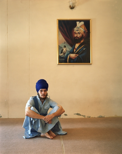<b>The Searchers (Part II)</b> American Sikh with portrait of Guru Gobind Singh, at an international Sikh boarding school (Amritsar, India)